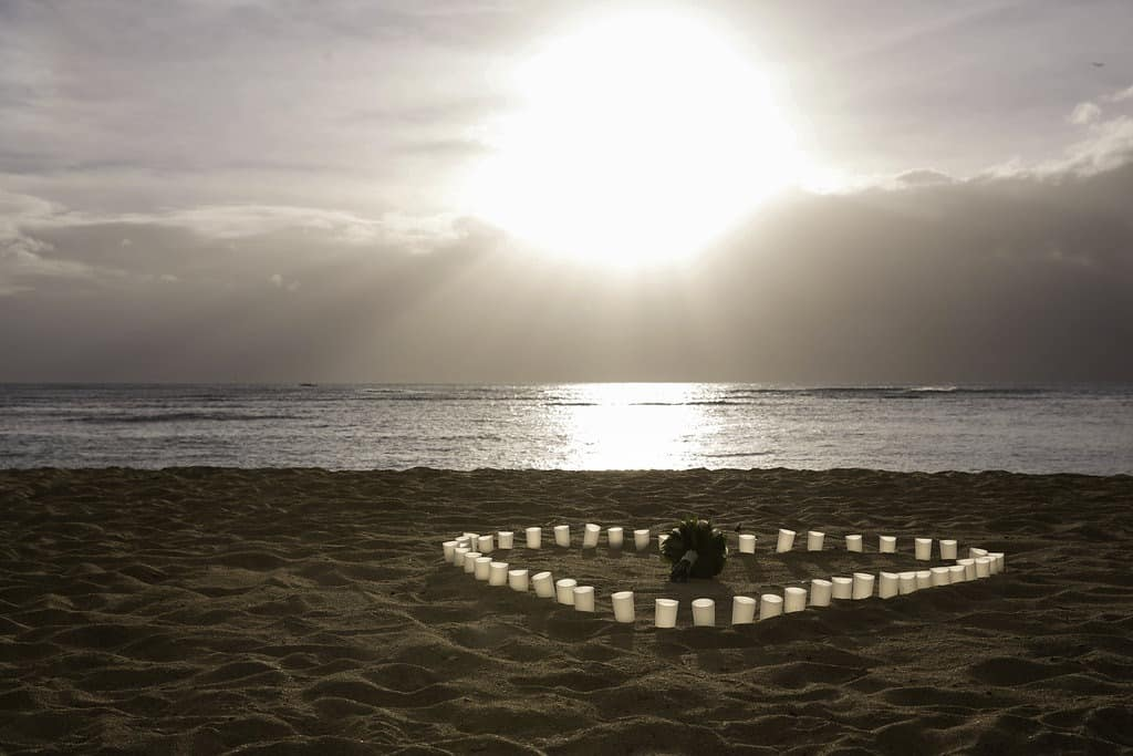 romantic proposal idea with candles on beach